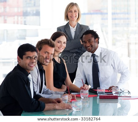 International business team smiling at the camera in office