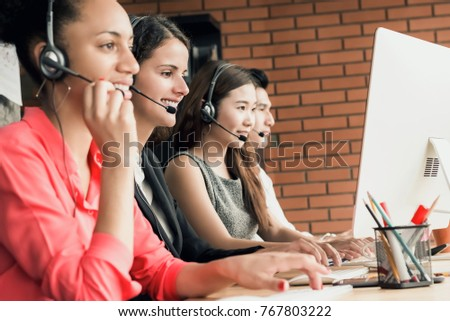 International call center telemarketing customer service agent team working in the office