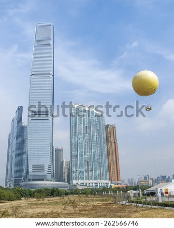 International commerce center tower and balloon in Hong Kong Kowloon skyline view