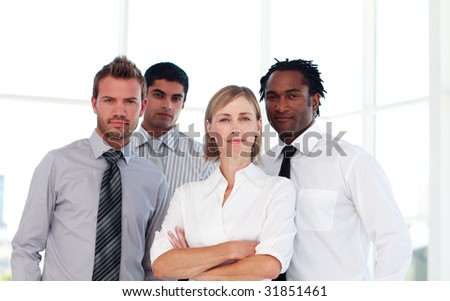 International confident business team looking at the camera