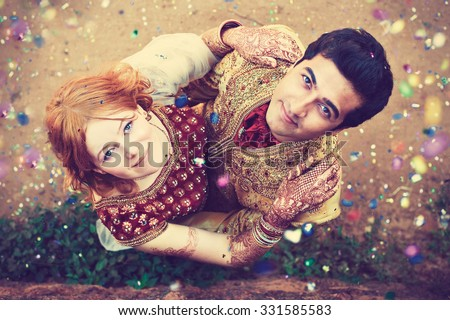 http://image.shutterstock.com/display_pic_with_logo/1511009/331585583/stock-photo-international-couple-indian-man-and-european-girl-in-indian-wedding-dresses-indian-wedding-331585583.jpg