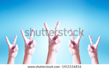 International Day of Cooperatives concept: human hands showing v-sign #1415156816