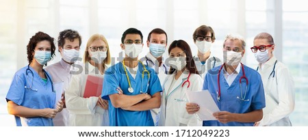 International doctor team. Hospital medical staff. Mixed race Asian and Caucasian doctor and nurse meeting. Clinic personnel wearing face mask and stethoscope. Coronavirus outbreak.
