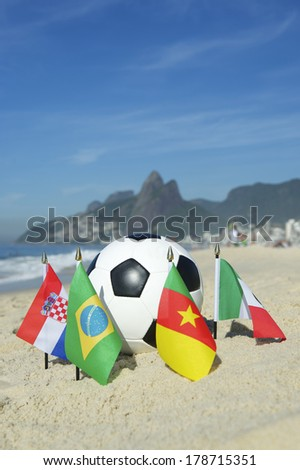 International football country Group A team flags with soccer ball on Ipanema beach in Rio de Janeiro Brazil