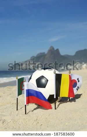 International football country Group H team flags with soccer ball on Ipanema beach in Rio de Janeiro Brazil