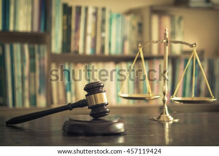 International human rights day concept: Judge gavel with scales on library.