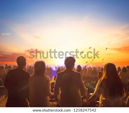 International Human Solidarity Day concept: Blurred Christian Congregation Worship God together in Church hall in front of music stage and light effected