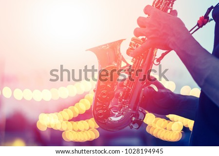 International Jazz day background. Saxophone, music instrument played by saxophonist player musician in festival