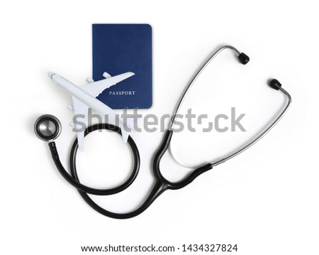 international medical travel insurance concept, stethoscope, passport and airplane isolated on white background