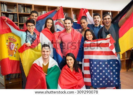 International multiethnic exchange of students, happy students presenting their countries with flags #309290078