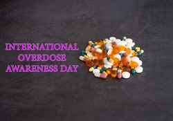 International Overdose Awareness Day is a global campaign that works towards preventing overdose, providing support to families and loved ones of overdose victims, selective focus, blurred background
