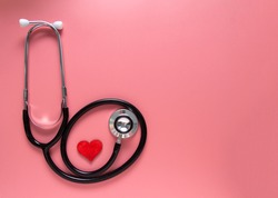 International's nurse day, week concept, stethoscope and red heart on pink background with copy space. Space for text