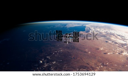 International Space Station (ISS) Orbiting Earth in Space - SpaceX & NASA Research - ISS Satellite Sunset View Low Orbit - 3D Model by NASA - 3D Rendering Foto stock ©