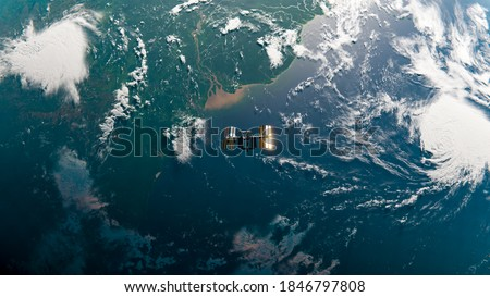 International Space Station (ISS) Orbiting Earth over Amazon River in Space Top Down View - Research - ISS Satellite Ocean Sunset View Low Orbit - 3D Rendering