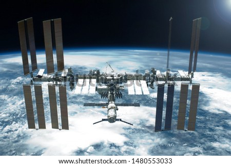 International Space Station over the planet. Elements of this image were furnished by NASA