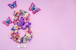 International Women's Day. Banner, flyer, beautiful postcard for March 8. Flowers and butterflies in the shape of the number 8 on a pink background.