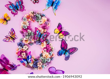 International Women's Day. Banner, flyer, beautiful postcard for March 8. Flowers and butterflies in the shape of the number 8 on a pink background. Foto stock ©