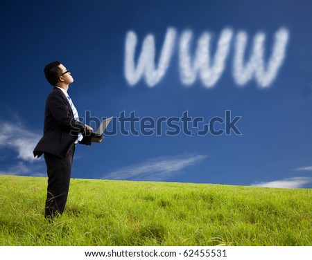 Internet cloud computing concept. businessman using laptop and watching internet cloud