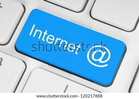 Internet concept on blue button of the keyboard