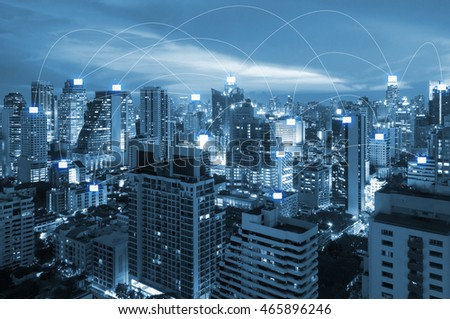 Internet connecting network line with e-mail icon over business of city centre for communication , business and technology concept #465896246