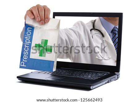 Internet drug store concept doctor holding prescription medicine through a laptop screen