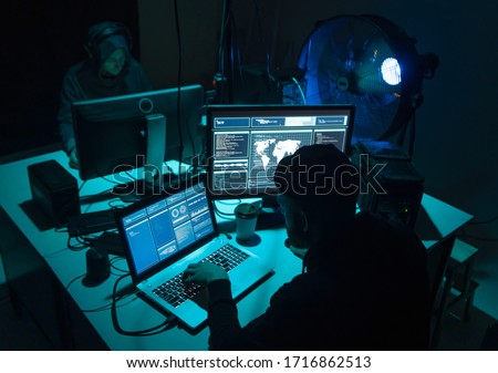 Internet fraud, darknet, data thiefs, cybercrime concept. Hacker attack on government server. Dangerous criminals coding virus programs. Stock photo ©