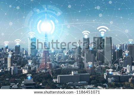 Internet of things connections concept. Smart city with icons of wireless connection transmitting internet signal to buildings, modern devices and many other things using internet.
