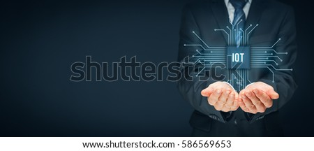 Internet of things (IoT) concept. Businessman offer IoT products and solutions. Abstract chip with text IoT connected with abstract devices represented by points.