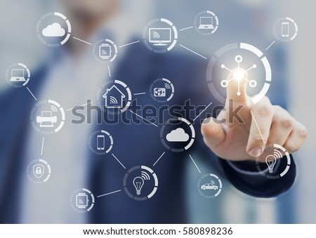 Internet of things (IOT) concept with a network of connected objects exchanging data with wireless connection, person touching virtual screen, smart home #580898236