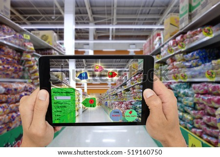 internet of things marketing concepts,smart augmented reality,customer hold the taplet to see product that search by ai application with show the hot deal,promotion code and show how far to product