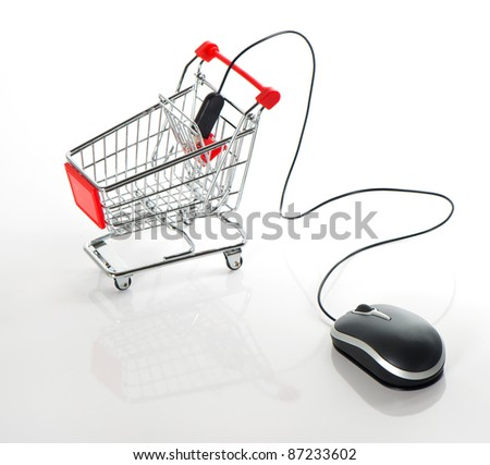 Internet online shopping concept. computer mouse and cart