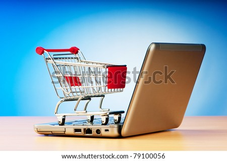 Internet online shopping concept with computer and cart