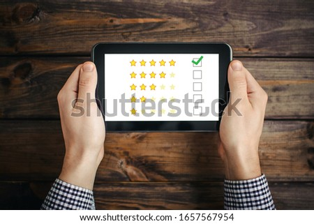 Internet satisfaction survey. Quality review at home. Rate us site. Customer rating background. Businessman holding tablet.round. Businessman holding tablet.