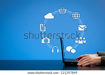 Internet services concept. Man with laptop and icons representing on-line services - discussion, social media, e-mail, web page, e-shop, cloud computing, document, photo, music.