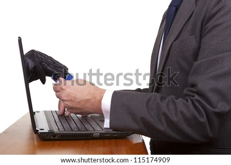 Internet theft - a gloved hand reaching out through a laptop screen to steal a credit card from a man.