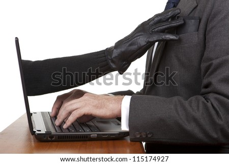 Internet theft - a gloved hand reaching out through a laptop screen to steal a wallet.
