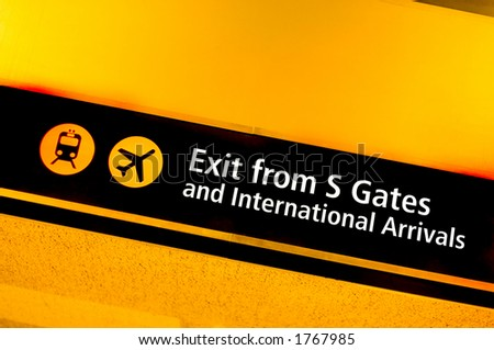 Interntional arrivals sign - stock photo