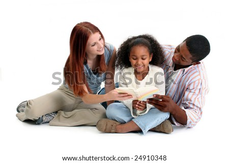 Interracial family, mom, dad, daughter, reading together over white.