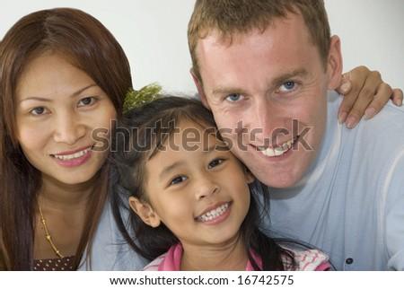 Interracial family of mixed ethnicity - stock photo