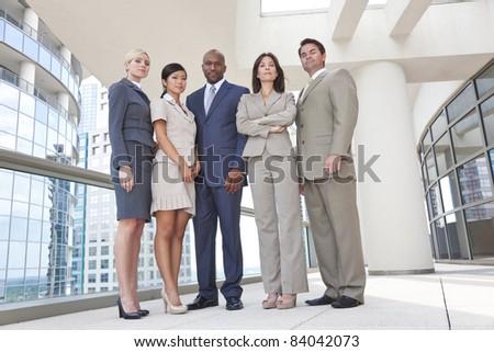 Interracial group of business men & women, businessmen and businesswomen team
