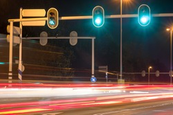 Intersection at night with traffic lights and traffic blurred by motion in Arnhem, Netherlands