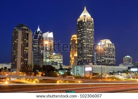 Interstate 85 runs below the skyline of Midtown Atlanta, Georgia, USA.