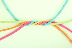 intertwined colorful cords on paper, abstract unity concept