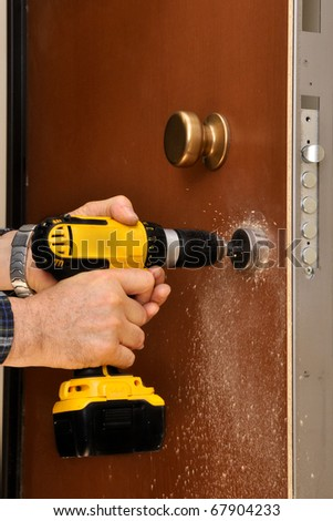 intervention to secure a door of an apartment - stock photo