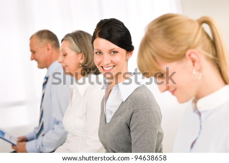 Interview applicants business people waiting young woman smiling - stock photo