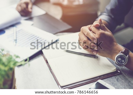 Interview or dialogue between businessman. Negotiation of two businessman with clasped hands in office. #786146656