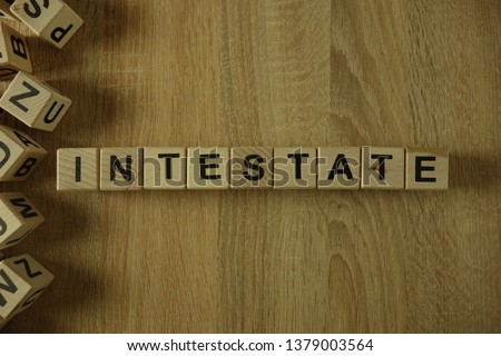 Intestate word from wooden blocks on desk Stock photo ©