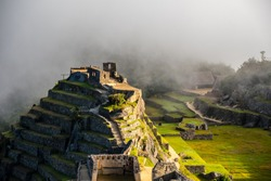 Intihuatana pyramid in a mist with ritual stone on Machu Picchu archeological site, Cusco, Peru, South America