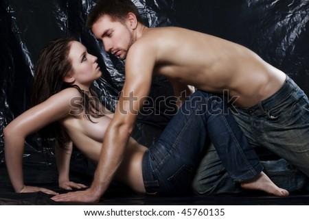 Intimate dark image of sensual couple foreplay