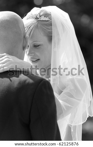 Intimate moment captured between a beautiful bride and groom
